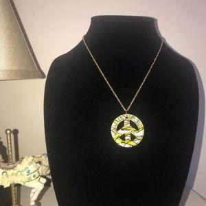 Yellow/ white glass peace symbol pendant w/ chain